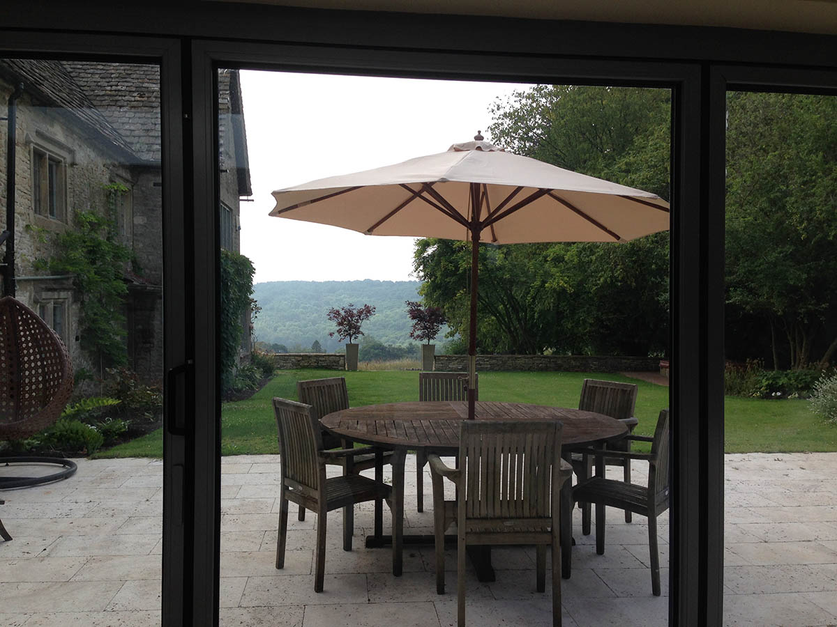 New entertaining terrace overlooking the valley with circular oak garden table to seat 6 or 8 people