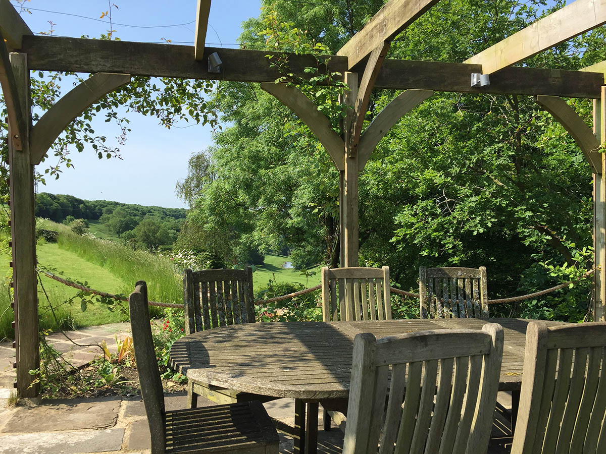 The oak table that seats 8 - 10 people situated at the head of the valley to enjoy those wonderful views.