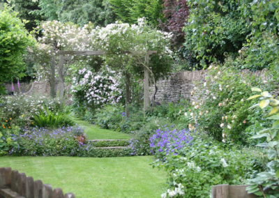 Looking up the garden from the orchard