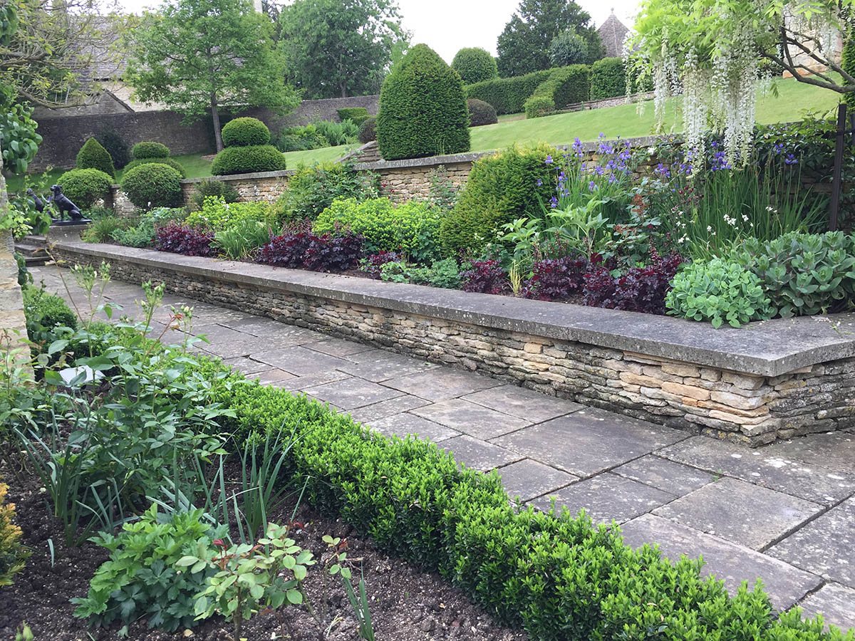 As you walk round the house from the formal Parterre outside the kitchen you see this late spring herbaceous bed and the view of the garden beyond