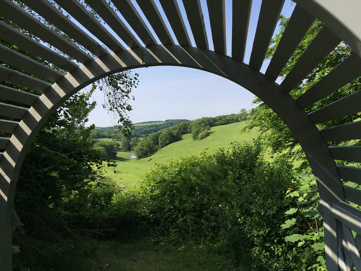 Half way up the bank from the woodland area you find this small wooden arbour where you can rest and enjoy the beautiful view.